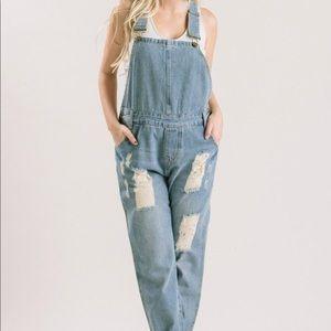 Denim distressed overalls